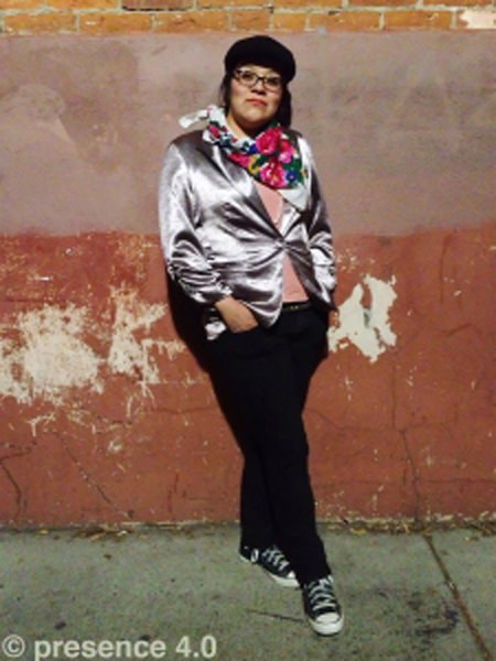 Presence 4.0 showcases the look of American Indian fashion today as seen on the streets to the dirt roads. Here Ashley flaunts a slick blazer with her iconic scarf still seen on many elder women today.