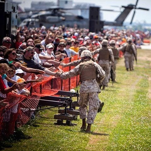 Marines greet the audience after an air-ground task force demonstration at Marine Week Cleveland in 2012. (Photo: Cpl. Marcin Platek, U.S. Marine Corps)